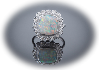Estate cushion-cut opal ring with diamonds in platinum