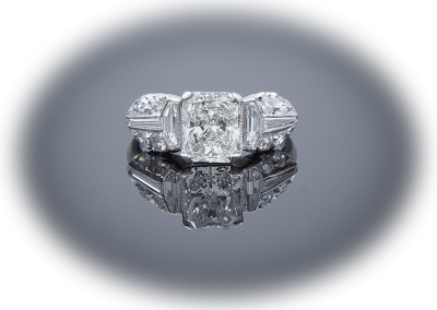 Estate ring with 1.50ct center diamond and 0.85ct side diamonds in platinum