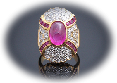 Estate ring with a 3ct cabochon ruby and 1.5ct diamonds in 18kt yellow gold