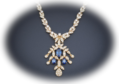 Necklace with 10 cts of diamonds and 6 cts of sapphires in 18kt yellow gold