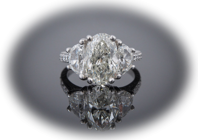 Ring with 3.48ct oval diamond in platinum