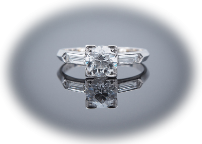 Ring with 1ct Old European Cut center diamond in platinum