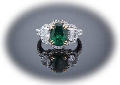 Ring with 2.19ct emerald and 1.26cts od diamonds in 18kt white and yellow gold