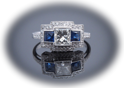 Ring with a 1 ct center diamond surrounded by diamonds and sapphires in platinum