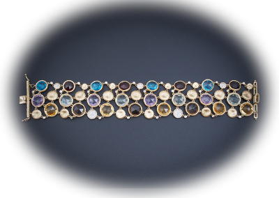 Mulit-colored gemstone bracelet in 14kt yellow gold