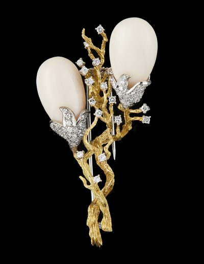 Estate brooch with angel skin coral and diamonds in platinum and 18kt yellow gold