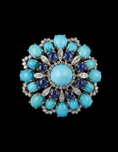Estate brooch with turquoise sapphires and diamonds in 18kt white gold