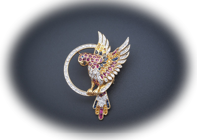 Parrot brooch with rubies, sapphires and diamonds in 18kt yellow gold