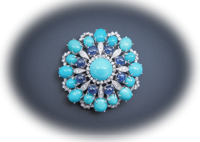 Turquoise, sapphire and diamond brooch in 14kt white gold
