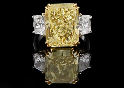 Ring with a 12.07 ct fancy yellow diamond and white diamonds in platinum and 18kt yellow gold
