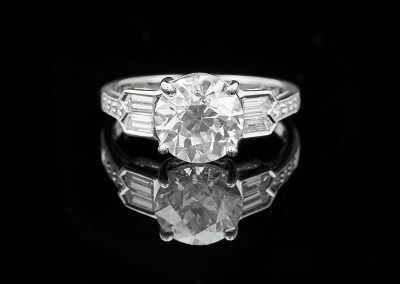 Ring with a 2.53 ct Old European Cut center diamond and 0.53 carats of side diamonds in platinum