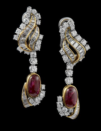 Earrings with 10.80 carats of rubies and 9.40 carats of diamonds in 18kt white and yellow gold