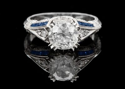 Ring with a 1.68 ct center diamond and sapphires in 18kt white gold