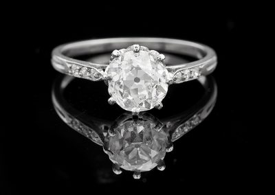 Estate ring with a 1.68 ct center diamond in a platinum crown mounting