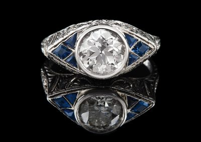 Estate ring with a 1.64 ct center diamond and sapphires in platinum