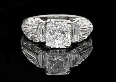 Estate ring with a 1.50 ct center diamond and 0.85 carats of side diamonds in platinum