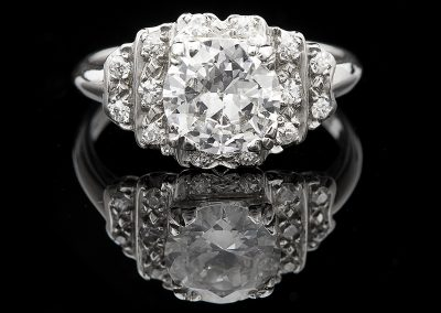 Estate ring with a 1.38 ct center diamond and 0.85 carats of side diamonds in platinum