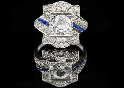 Ring with a 1.37 ct center diamond and 0.85 carats of side diamonds with sapphires in platinum