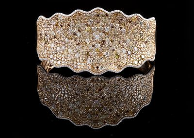 Bracelet with 18.04 carats of white and colored diamonds in 18kt rose gold