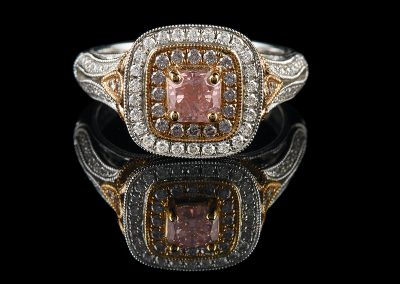 Ring with a 0.53 ct pink center diamond and 0 19 carats of side pink diamonds and 0 27 carats of white diamonds in 18kt white and rose gold