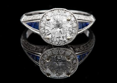 Ring with a 1.18 ct center diamond and 0.38 carats of side diamonds and sapphires in 14kt white gold