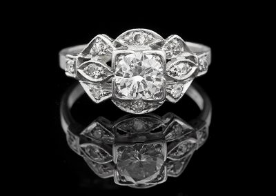 Estate ring with a 0.60 ct center diamond in platinum