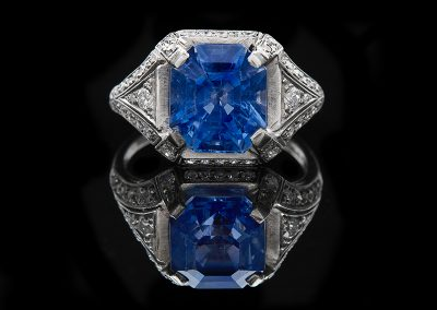 Estate ring with a 6.38 ct blue sapphire and 0.50 carats of diamonds in platinum
