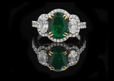 Ring with a 2.19 ct emerald and 1.26 carats of diamonds in 18kt white and yellow gold