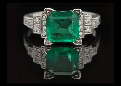 Estate ring with a 1.84 ct emerald and 0.09 carats of diamonds in 18kt white gold