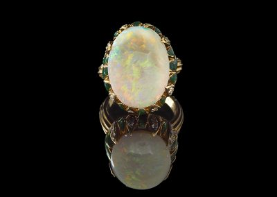 Estate ring with a 15 ct opal and 0.50 carats of diamonds in enamel and 18kt yellow gold