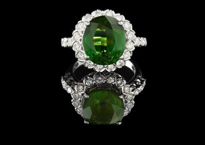 Cocktail ring with a 6.90 ct green tourmaline and 1 carat of diamonds in 18kt white gold