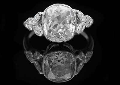 Ring with a 3.47 ct center cushion Old Mine cut diamond and 0.35 carats of side diamonds in platinum