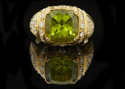 Cocktail ring with a 6.09 ct peridot and apx 1 carat of diamonds in 18kt yellow gold