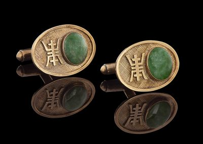 Estate jade cufflinks in 14kt yellow gold